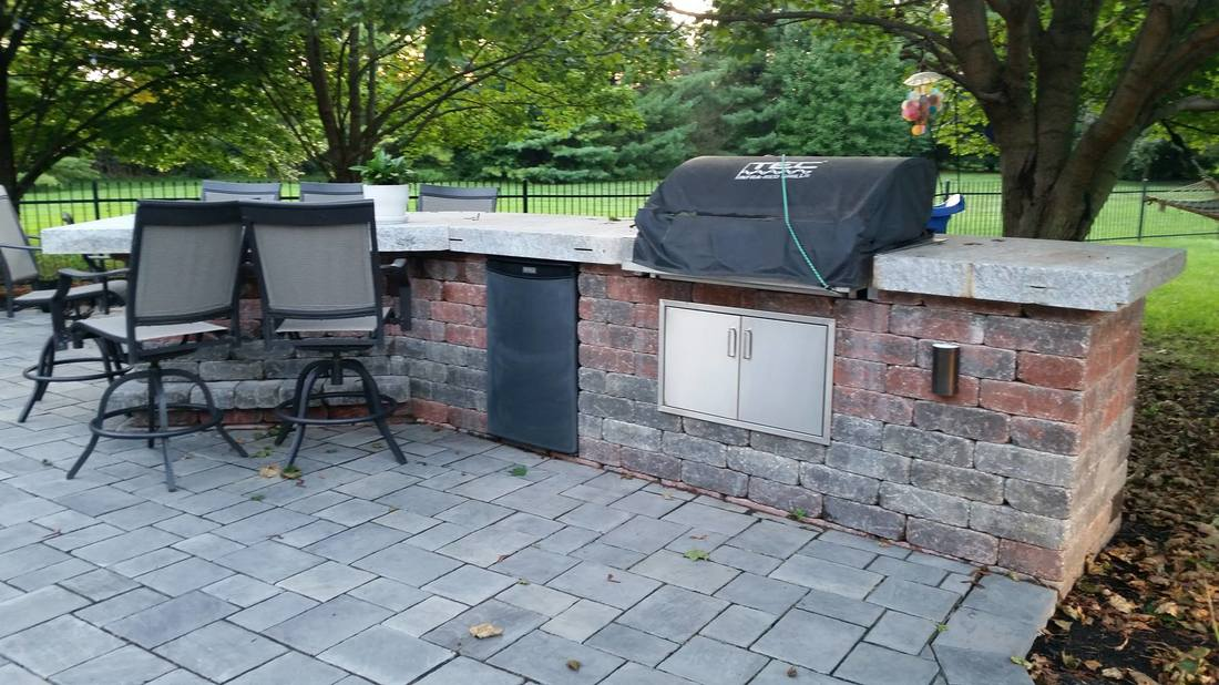 outside kitchen with a covered bbq grill