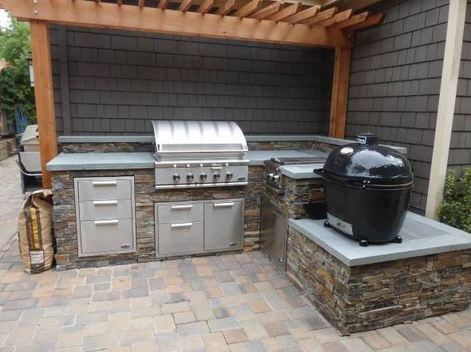 picture of a custom outdoor kitchen next to the house